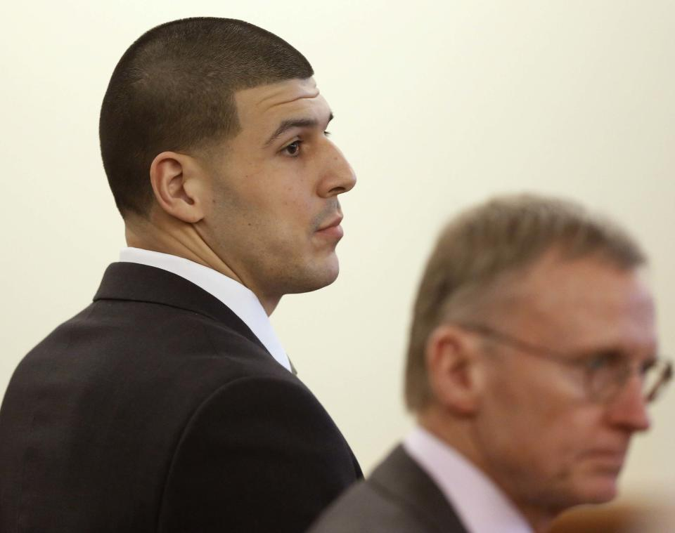 Former New England Patriots football player Aaron Hernandez (L) and defense attorney Charles Rankin listen during his trial in Fall River, Massachusetts, January 29, 2015, Hernandez is accused of murdering semi-professional football player Odin Lloyd. REUTERS/Steven Senne/Pool (UNITED STATES - Tags: SPORT FOOTBALL CRIME LAW)