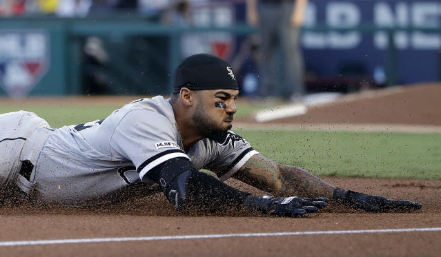 Chicago White Sox's Leury Garcia slides into third base with a triple during the first inning of the team's baseball game against the Los Angeles Angels on Saturday, Aug. 17, 2019, in Anaheim, Calif. (AP Photo/Marcio Jose Sanchez)