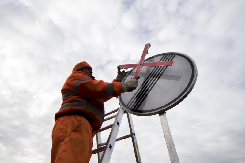 BIRKENWERDER, GERMANY - FEBRUARY 07: An employee of the road maintenance depot prepares a road sign for the finish of speed limit on February 07, 2019 in Birkenwerder, Germany. (Photo by Florian Gaertner/Photothek via Getty Images)