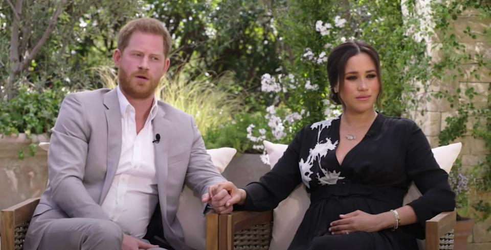The Duke and Duchess of Sussex pictured in a still from their interview with Oprah Winfrey. (Photo: CBS)