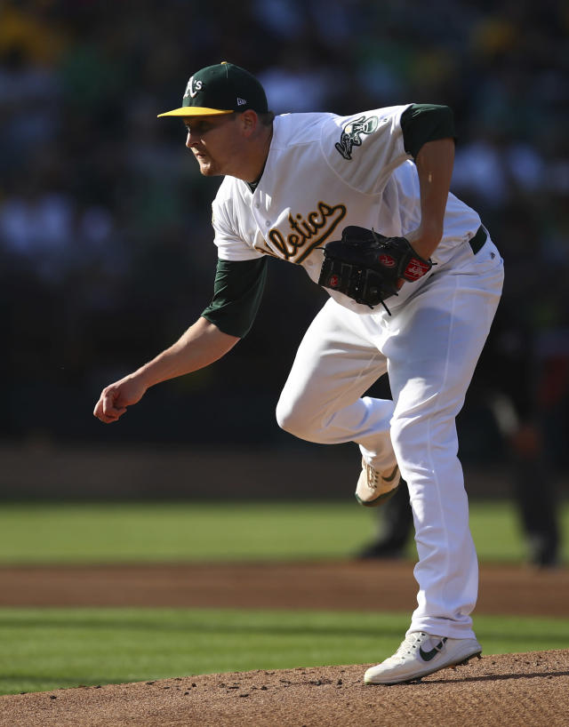Oakland Athletics pitcher Trevor Cahill watches a throw to a San Francisco Giants batter during the first inning of a baseball game Saturday, July 21, 2018, in Oakland, Calif. (AP Photo/Ben Margot)