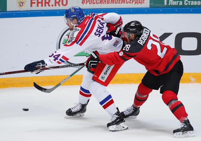 <p>The Calgary, Alberta, native (right) is currently playing for CSKA Moscow in the Kontinental Hockey League. He was not drafted in the NHL, but has played several seasons in both the KHL as well as the Swedish Elite League. </p>