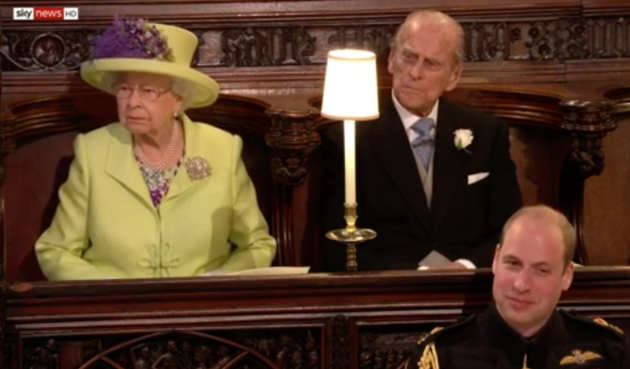 The Queen does not look amused - unlike her grandson and best man on the day, Prince William.