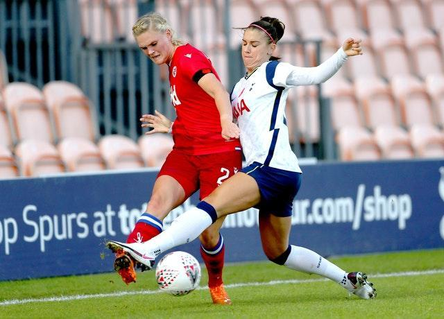 Alex Morgan, right, made her long-awaited debut for Tottenham Women - almost two months after signing - in their 1-1 draw with Reading in the Women's Super League