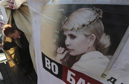 A woman walks out from a tent at a protest camp set up by supporters of jailed former Ukrainian PM and opposition leader Tymoshenko in central Kiev