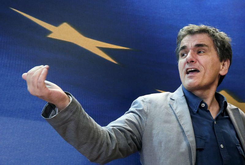 Greek Finance Minister Euclid Tsakalotos reacts as he arrives for a handover ceremony in Athens