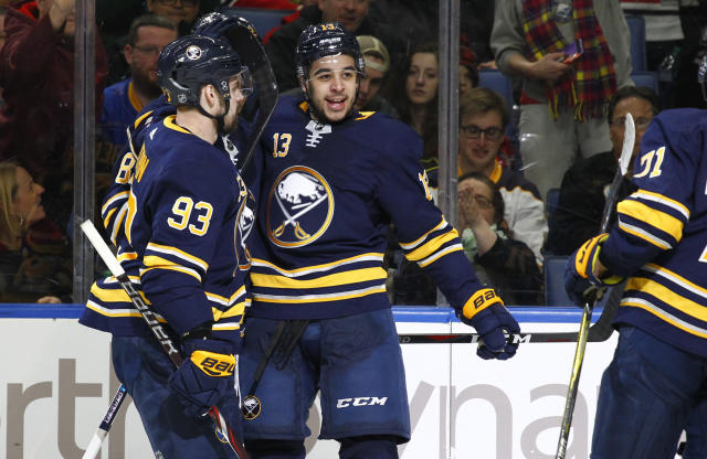 Buffalo Sabres Victor Antipin (93) and Nicholas Baptiste (13) celebrate a goal during the third period of an NHL hockey game against the Chicago Blackhawks, Saturday, March 17, 2018, in Buffalo, N.Y. (AP Photo/Jeffrey T. Barnes)
