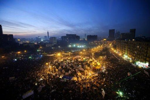 Tens of thousands of protesters rallied in Cairo to pile pressure on President Mohamed Morsi after a panel dominated by fellow Islamists rushed through a controversial draft constitution