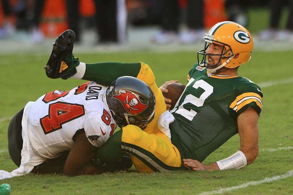Aaron Rodgers is sacked by Lavonte David.