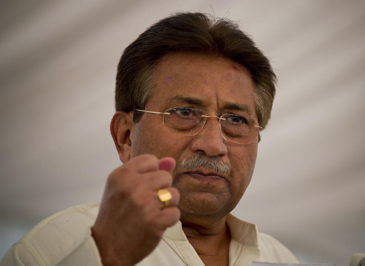 In this Monday, April 15, 2013 photo, Pakistan's former President and military ruler Pervez Musharraf addresses his party supporters at his house in Islamabad, Pakistan. Police arrested former Pakistani military ruler Pervez Musharraf overnight at his home in the capital, where he had holed up following a dramatic escape from court to avoid being detained, officials said Friday. (AP Photo/B.K. Bangash)