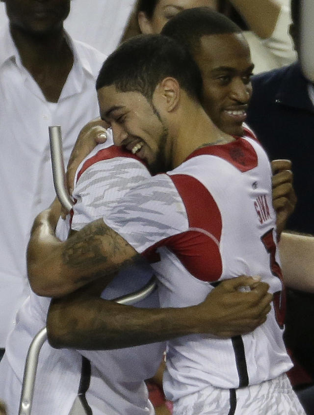 Louisville guard Kevin Ware, left, and Louisville guard Peyton Siva (3) embrace after Louisville defeated Michigan during the second half of the NCAA Final Four tournament college basketball championship game Monday, April 8, 2013, in Atlanta. Louisville won 82-76. (AP Photo/Chris O'Meara)