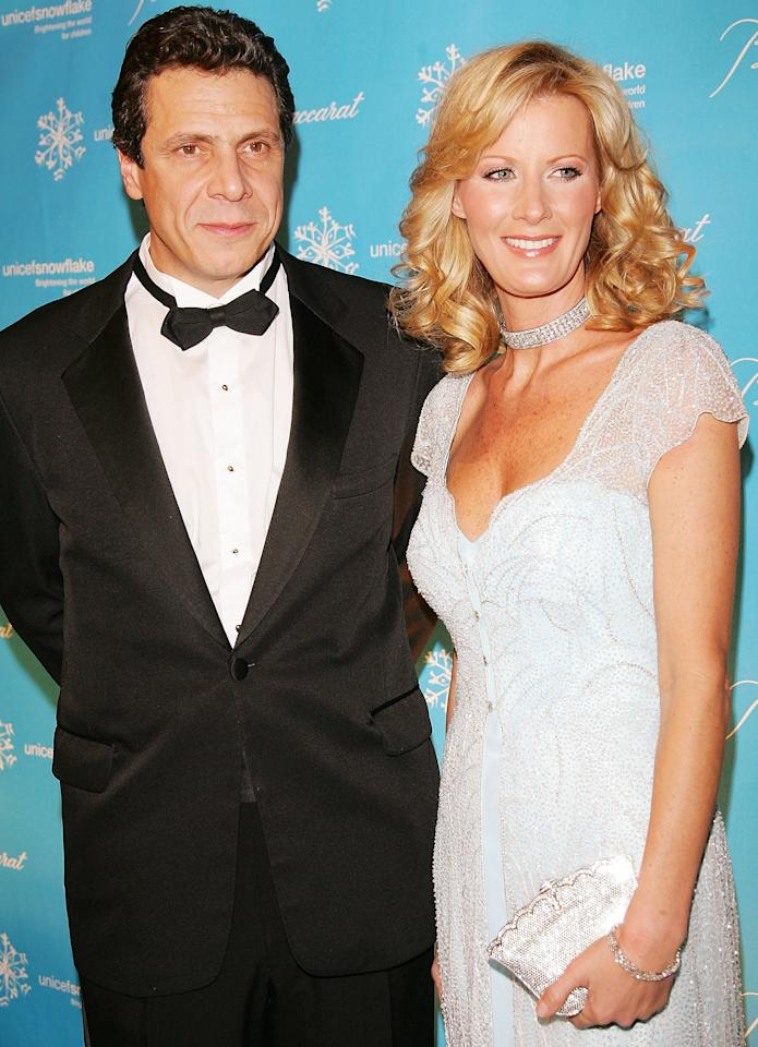 "From left: Cuomo, then New York's attorney general-elect, and Lee attended the Third Annual UNICEF Snowflake Ball at Cipriani's 42nd Street in November 2006 in New York City.   The two had first met a year earlier, at a summer party in the Hamptons.  ""I remember her being — I don't want to say infatuated, because it sounds too schoolgirlish — but she was taken with him,"" Lee's friend Colleen Schmidt <a href=""https://www.nytimes.com/2010/05/15/nyregion/15sandralee.html"">told the <em>Times</em> in 2010</a>.  In the spirit of other first ladies — a title she may have only held unofficially, as New York's ""first girlfriend"" — Lee had her own causes. She is a founding member of the L.A. chapter of UNICEF and has supported efforts <a href=""https://www.nytimes.com/2011/03/30/nyregion/on-sandra-lees-lips-food-bank-not-budget.html"">to end childhood hunger</a>, among other issues."