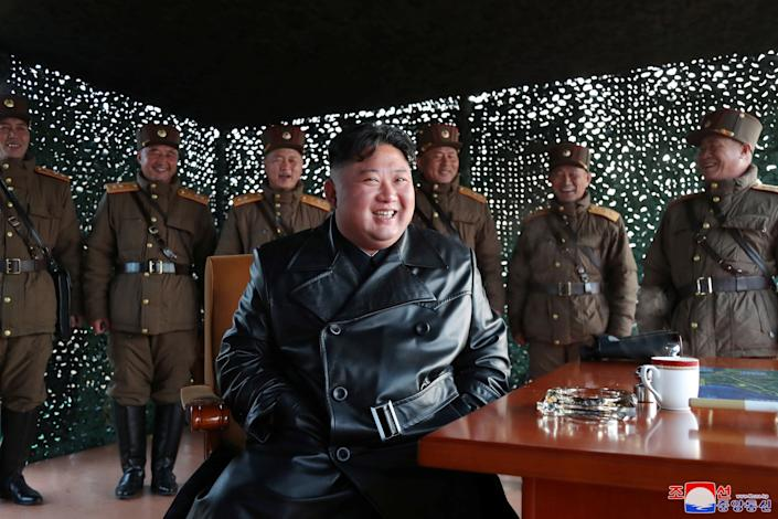 North Korean leader Kim Jong Un smiles after witnessing the firing of what's believed to be two short-range ballistic missiles on Saturday. (Photo: KCNA KCNA / Reuters)