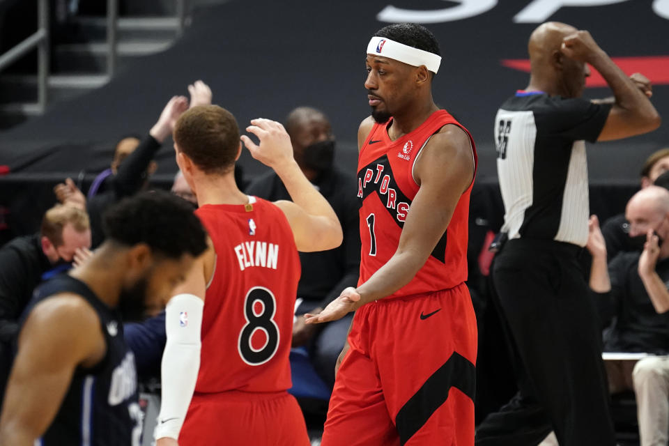 Toronto Raptors guard Paul Watson Jr., (1) celebrates with guard Malachi Flynn (8) after a play against the Orlando Magic during the second half of an NBA basketball game Friday, April 16, 2021, in Tampa, Fla. (AP Photo/Chris O'Meara)