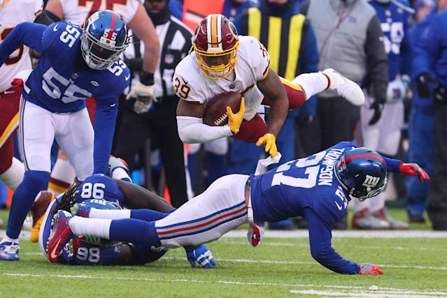 <p>Darian Thompson #27 of the New York Giants tackles Keith Marshall #39 of the Washington Redskins during the second half at MetLife Stadium on December 31, 2017 in East Rutherford, New Jersey. The Giants defeated the Redskins 18-10. (Photo by Ed Mulholland/Getty Images) </p>