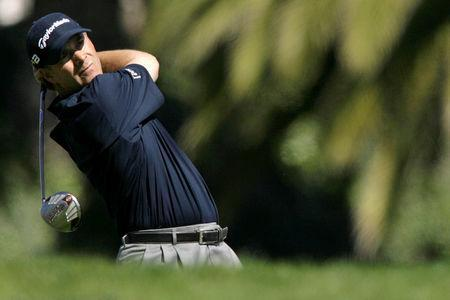 FILE PHOTO: Scott McCarron of the U.S. tees off on third hole during the second round of the Northern Trust Open PGA golf tournament at Riviera Country Club in Los Angeles, February 15, 2008. REUTERS/Danny Moloshok/File Photo