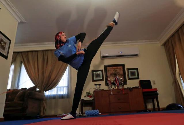 Egyptian Taekwondo practitioner and 2016 Rio Olympics bronze medallist Wahba works out at her home amidst the spread of the coronavirus disease (COVID-19) in Cairo