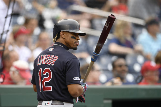 FILE - In this Sept. 28, 2019 file photo Cleveland Indians' Francisco Lindor warms up before a baseball game against the Washington Nationals in Washington. Lindor insists he wants to stay in Cleveland. The Indians would like that, too. Money, though, could get in the way. The four-time All-Star shortstop reiterated in Arizona that he would prefer to play with the Indians beyond 2021 when his contract expires. The Indians have made long-term offers to him in the past and will continue negotiations. But the deeper in the season it gets, the more the club will have to consider trading Lindor or watch him walk away as a free agent. The Indians held their first full-squad workout of training camp on Monday, Feb. 17 2020. (AP Photo/Nick Wass)