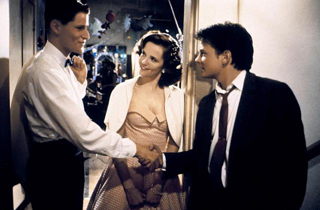 <p>Here, Marty (Michael J. Fox) is introducing his parents to one another in order to ensure his existence in the future. Mom Lorraine (Lea Thompson) is wearing a classic strapless pink prom dress that is stylish through the ages. (Photo: Everett Collection) </p>