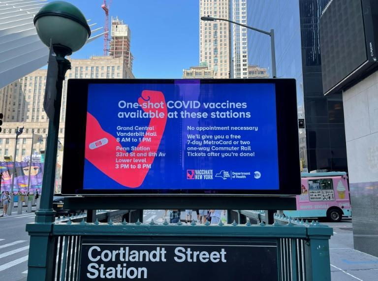 An ad outside a subway station in New York City calls for people to get vaccinated against Covid-19