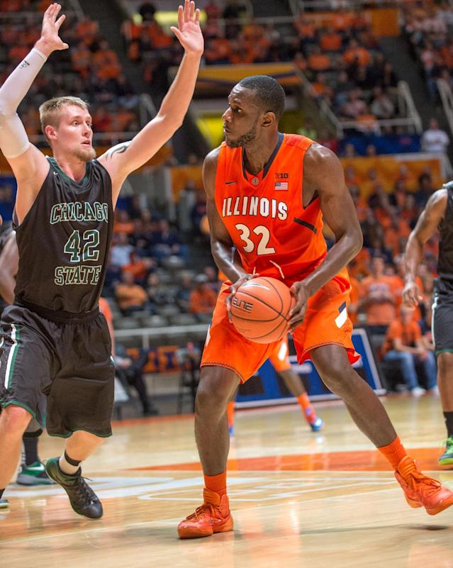 Illinois' Nnanna Egwu (32) moves to shoot over Chicago State's Matt Ross (42) during the second half of an NCAA college basketball game on Friday, Nov. 22, 2013, in Champaign, Ill. Illinois defeated Chicago State 77-53. (AP Photo/Darrell Hoemann)