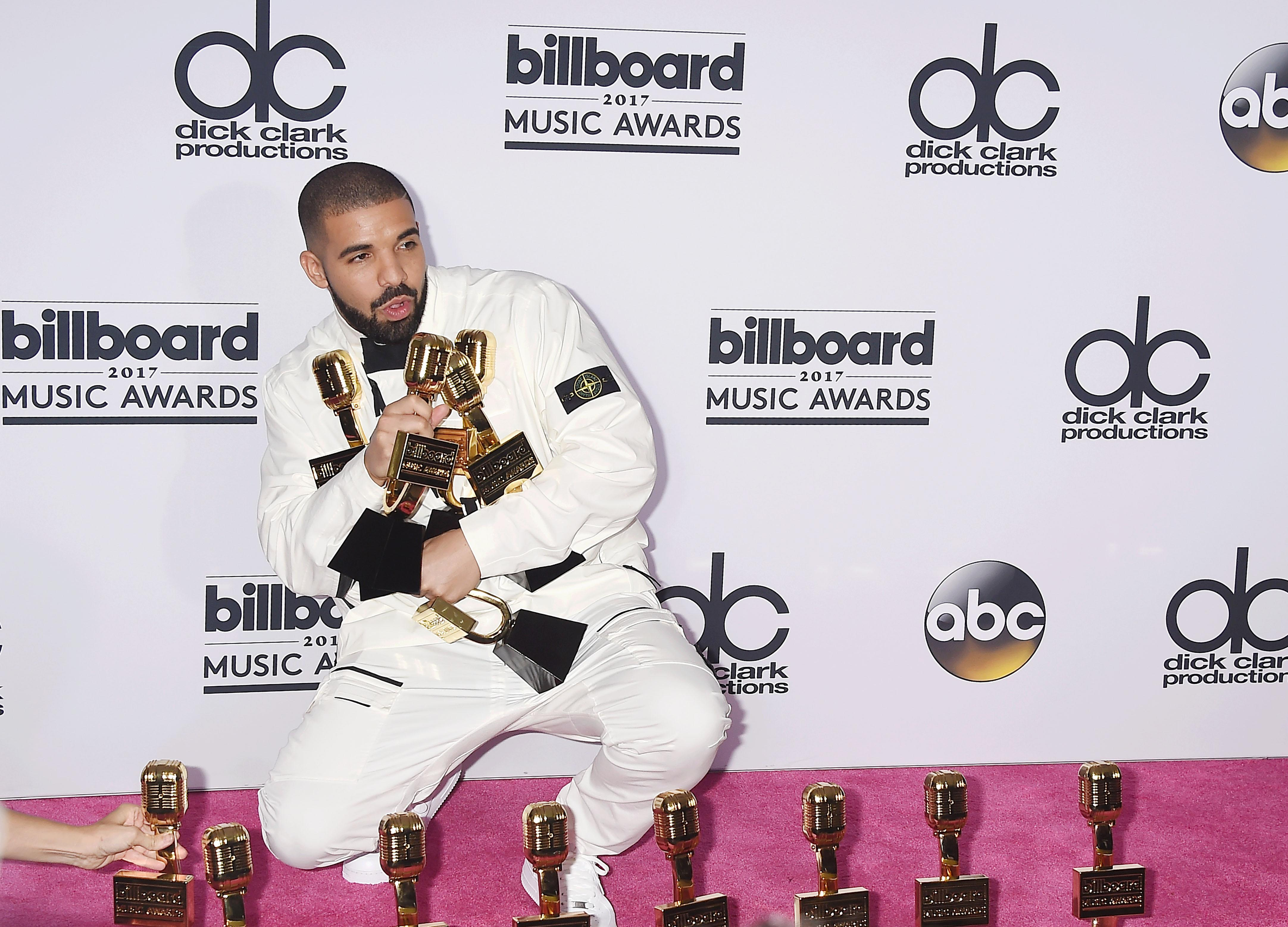 6b8bdf52aaf29 Rapper-singer-songwriter Drake poses with awards at the 2017 Billboard  Music Awards at T-Mobile Arena on May 21, 2017, in Las Vegas.