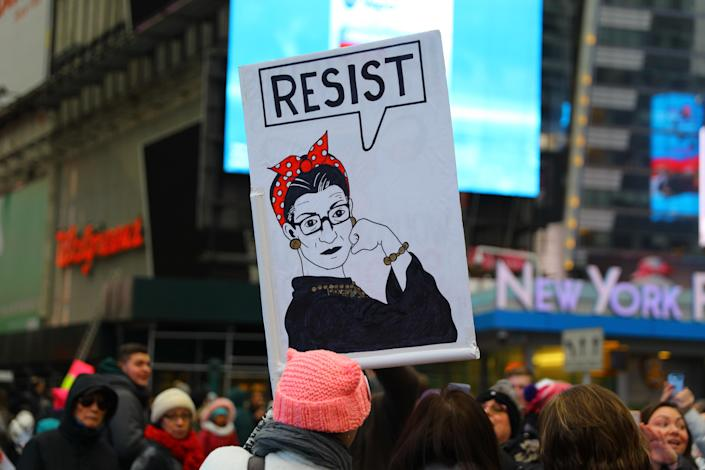 """A supporter holds up a sign based on Rosie the Riveter with word """"resist"""" after marching in the Women's March on Jan. 19, 2019 in New York City. (Photo: Gordon Donovan/Yahoo News)"""