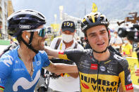 Second placed Spain's Alejandro Valverde, left, congratulates stage winner Sepp Kuss of the US after the fifteenth stage of the Tour de France cycling race over 191.3 kilometers (118.9 miles) with start in Ceret and finish in Andorra-la-Vella, Andorra, Sunday, July 11, 2021. (Thomas Samson/Pool Photo via AP)