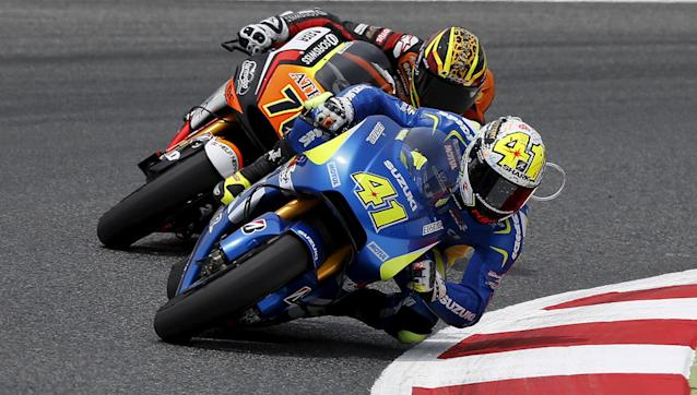 Suzuki Moto GP rider Aleix Espargaro take a curve followed by Yamaha Moto GP rider Loris Baz of France during the qualifying session of the Catalunya Grand Prix at the Barcelona-Catalunya circuit, in Montmelo near Barcelona, Spain, June 13, 2015. Espargaro broke the lap record to take pole position at the Catalunya Grand Prix with Maverick Vinales behind him on Saturday in a surprise Suzuki pairing at the front of the MotoGP grid. REUTERS/Gustau Nacarino