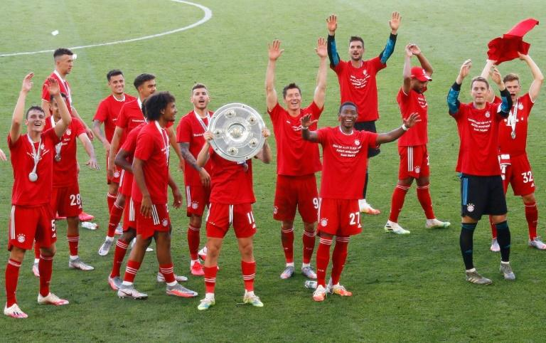 Bayern Munich players celebrate with the Bundesliga trophy on Saturday