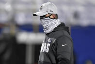Baltimore Ravens head coach John Harbaugh leaves the field after an NFL divisional round football game against the Buffalo Bills Saturday, Jan. 16, 2021, in Orchard Park, N.Y. The Bills won 17-3. (AP Photo/Adrian Kraus)