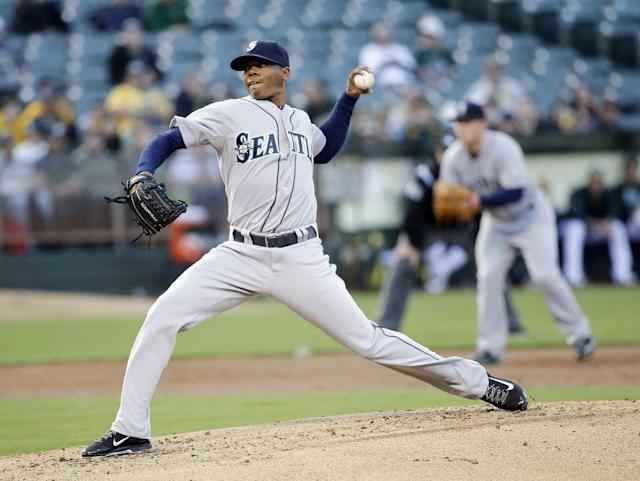 Seattle Mariners starting pitcher Roenis Elias throws against the Oakland Athletics during the first inning of a baseball game on Tuesday, May 6, 2014, in Oakland, Calif. (AP Photo/Marcio Jose Sanchez)
