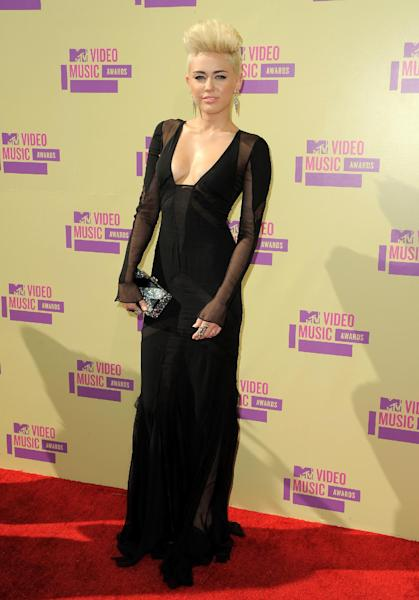 FILE - In this Sept. 6, 2012 file photo, Miley Cyrus attends the MTV Video Music Awards in Los Angeles. City attorney's spokesman Frank Mateljan says Jason Luis Rivera was charged Monday, Sept. 10, 2012 with two counts of trespassing after his weekend arrest at the actress-singer's Los Angeles home and one count resisting arrest. (Photo by Jordan Strauss/Invision/AP, file)