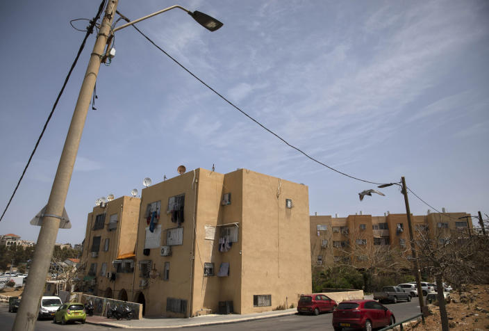 Older apartments are inhabited by Arabs in the Jaffa neighborhood of Tel Aviv, Israel, Wednesday, April 21, 2021. Historic Jaffa's rapid gentrification in recent years is coming at the expense of its mostly Arab lower class. With housing prices out of reach, discontent over the city's rapid transformation into a bastion for Israel's ultra-wealthy is reaching a boiling point. (AP Photo/Sebastian Scheiner)