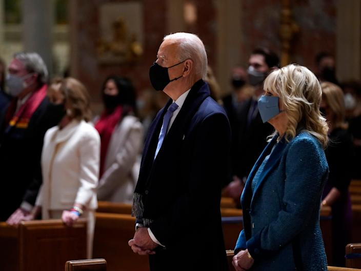 President-elect Joe Biden is joined his wife Jill Biden as they celebrate Mass at the Cathedral of St. Matthew the Apostle during Inauguration Day ceremonies Wednesday on 20 January 2021, in Washington ((Associated Press))