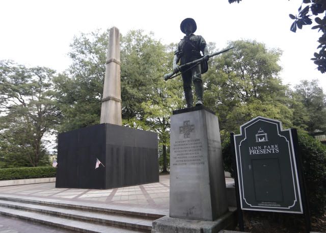 <p>A monument to volunteers of the Army of the Republic stands next to a confederate monument covered up by the mayor of Birmingham in Linn Park August 18, 2017 in Birmingham, Ala. Alabamas attorney general Steve Marshall sued the city of Birmingham and the mayor for partially covering the Confederate monument with a wooden box, citing it violated the Alabama Memorial Preservation Act. (Photo: Hal Yeager/Getty Images) </p>