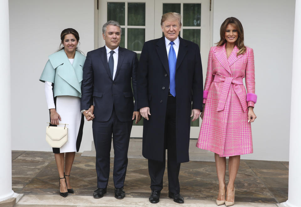 Melania Trump wore a Fendi coat to welcome the President and First Lady of Colombia. [Photo: PA]