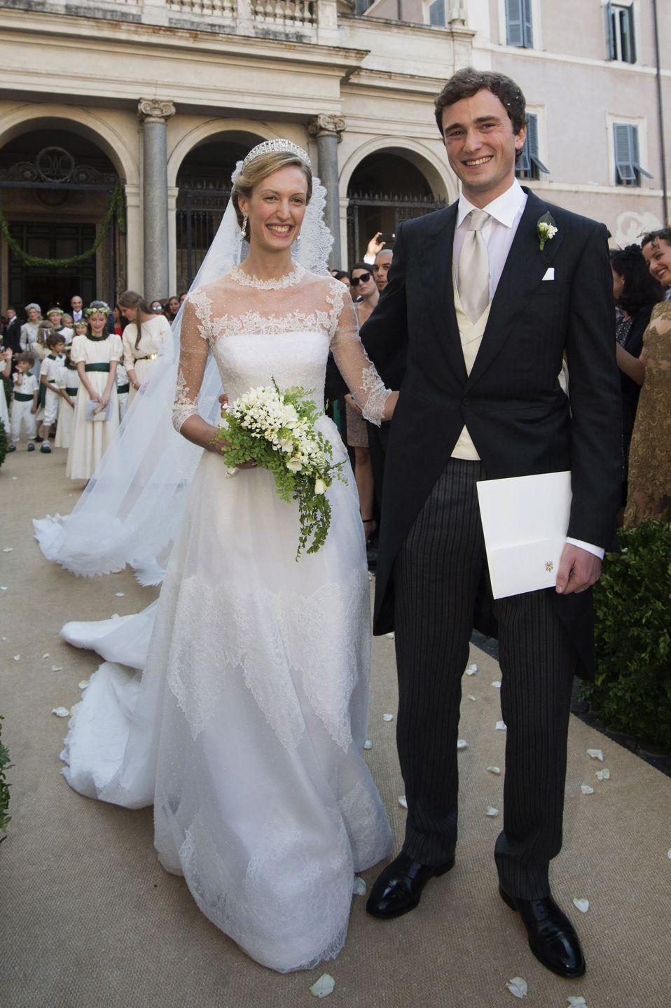 <p>Journalist Elisabetta Rosboch wore a Valentino gown with delicate, sheer details for her wedding to the nephew of reining Belgian monarch King Philippe. </p>