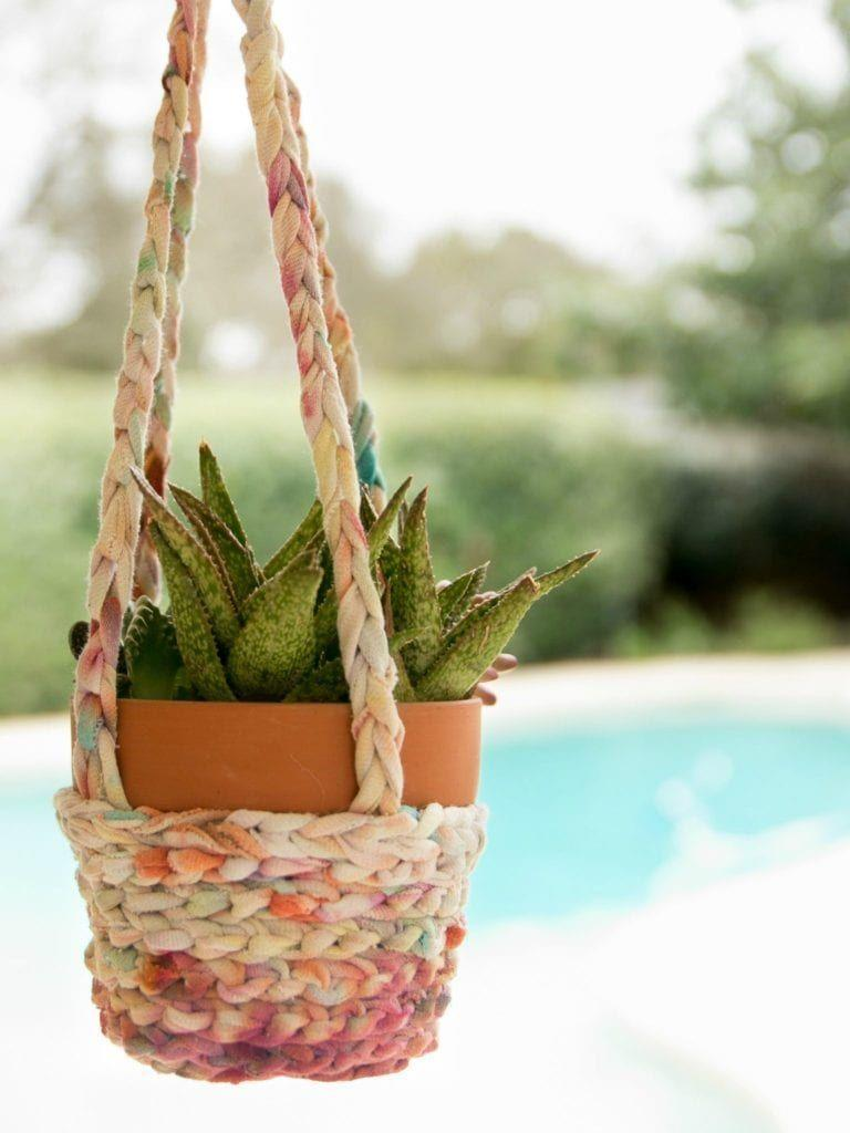 """<p>You know those old, well-loved tie-dye T-shirts you have lying around? Put them to good use by making this groovy hanging planter. </p><p><strong>Get the tutorial at <a href=""""https://jenniferperkins.com/tie-dye-t-shirts-turned-boho-hanging-baskets/"""" rel=""""nofollow noopener"""" target=""""_blank"""" data-ylk=""""slk:Jennifer Perkins"""" class=""""link rapid-noclick-resp"""">Jennifer Perkins</a>.</strong></p><p><a class=""""link rapid-noclick-resp"""" href=""""https://go.redirectingat.com?id=74968X1596630&url=https%3A%2F%2Fwww.walmart.com%2Fip%2FAdTech-Mini-High-Temp-Basic-Hot-Glue-Gun%2F120772424&sref=https%3A%2F%2Fwww.thepioneerwoman.com%2Fhome-lifestyle%2Fgardening%2Fg36556911%2Fdiy-planters%2F"""" rel=""""nofollow noopener"""" target=""""_blank"""" data-ylk=""""slk:SHOP HOT GLUE GUNS"""">SHOP HOT GLUE GUNS</a></p>"""
