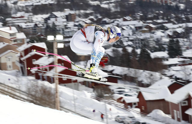 Lindsey Vonn speeds down the course during the women's downhill race, at the alpine ski World Championships in Are, Sweden, Sunday, Feb. 10, 2019. (AP Photo/Gabriele Facciotti)