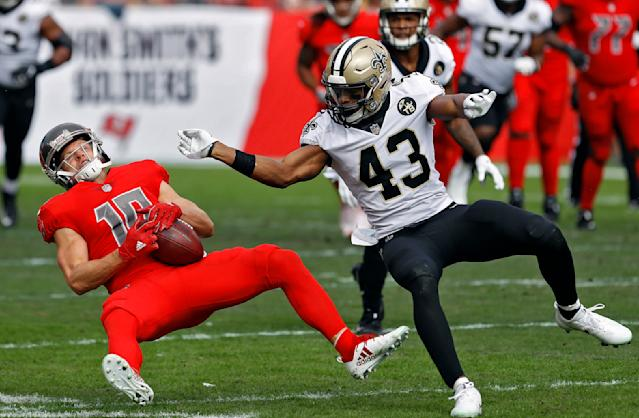 <p>New Orleans Saints free safety Marcus Williams (43) levels Tampa Bay Buccaneers wide receiver Adam Humphries (10) after a reception during the first half of an NFL football game Sunday, Dec. 9, 2018, in Tampa, Fla. (AP Photo/Mark LoMoglio) </p>