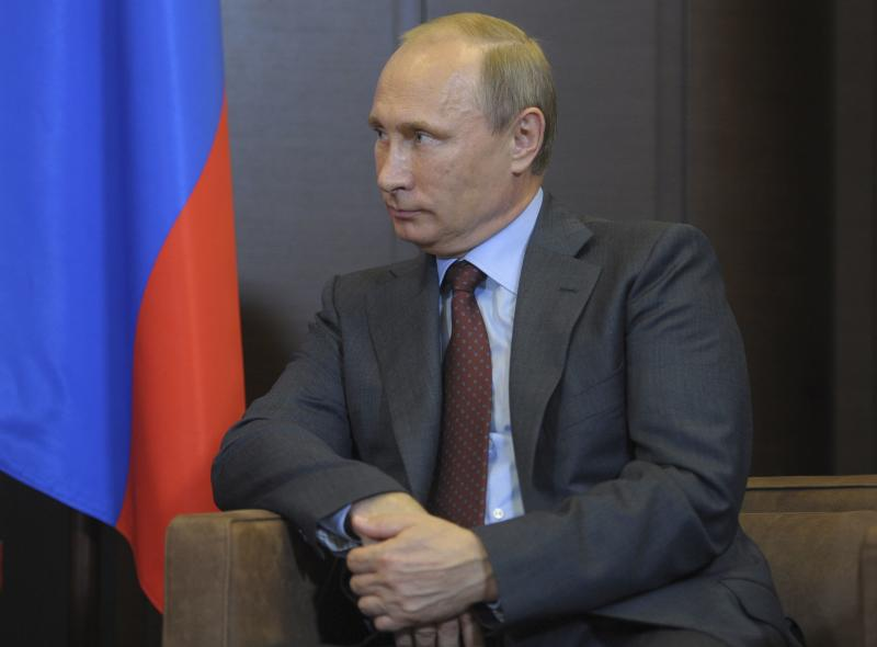 Russia's President Putin listens to Azerbaijan's President Aliyev during their meeting in Sochi