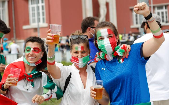 Fans gather for Italy v Wales - Rome, Italy- June 20, 2021 Italy fans pose ahead of the match - REUTERS