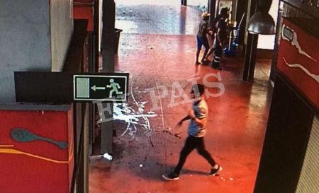 A watermarked CCTV frame grab provided by Spanish newspaper El Pais shows a suspect walking through La Boqueria market seconds after a van crashed into pedestrians in Barcelona, Spain, August 17, 2017. Courtesy of El Pais via REUTERS