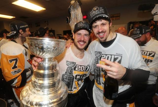 <p>Pittsburgh Penguins center Sidney Crosby (left) and center Evgeni Malkin (right) celebrate with the Stanley Cup after defeating the Nashville Predators in Game 6 of the 2017 Stanley Cup Final at Bridgestone Arena. Mandatory Credit: Dave Sandford/NHLI/Pool Photo via USA TODAY Sports </p>