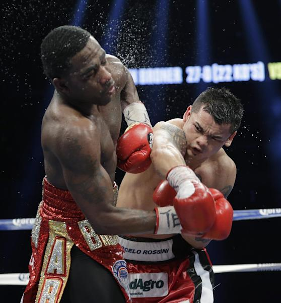 Marcos Rene Maidana, right, lands a punch on Adrien Broner, left, during an WBA welterweight title bout, Saturday, Dec. 14, 2013, in San Antonio. (AP Photo/Eric Gay)