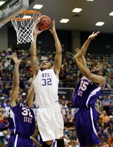 Stephen F. Austin's Taylor Smith (32) shoots as Northwestern State's DeQuan Hicks, left, and O.J. Evans (35) defend during the first half of the Southland Conference championship NCAA college basketball game, Saturday, March 16, 2013, in Katy, Texas. (AP Photo/David J. Phillip)