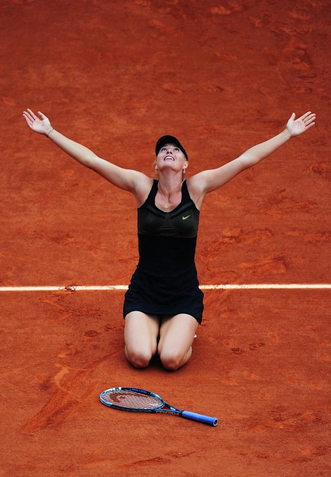 PARIS, FRANCE - JUNE 09:  Maria Sharapova of Russia celebrates victory in the women's singles final against Sara Errani of Italy during day 14 of the French Open at Roland Garros on June 9, 2012 in Paris, France.  (Photo by Mike Hewitt/Getty Images)