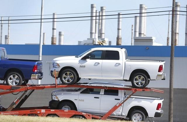 A car hauler transports new Dodge Ram pickup trucks from the Fiat Chrysler Automobiles (FCA) Warren Truck Assembly plant in Warren, Michiga