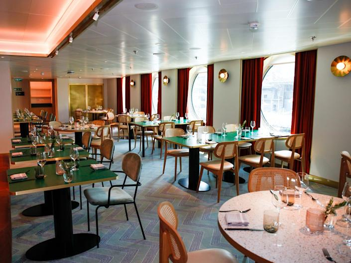 The Extra Virgin restaurant with tables by windows